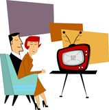 Couple watching new tv. Retro couple watching their brand new tv from fifties Royalty Free Stock Photography