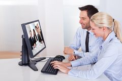 Couple watching an online presentation Stock Photo