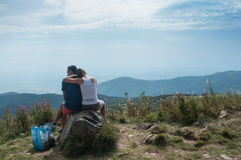 Couple watching the panorama on rock Royalty Free Stock Photos