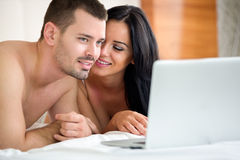 Couple watching porn movie Stock Photography