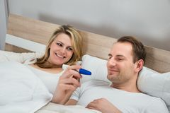 Couple watching pregnancy test Stock Images