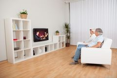 Couple watching romantic television Royalty Free Stock Image