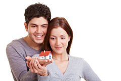 Couple watching a small house Stock Photos