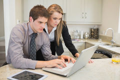 Couple watching something on the laptop Stock Photography