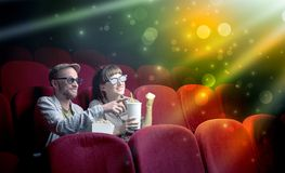 Couple watching something miraculous. Fanciful couple watching miraculous part of a movie Stock Photography