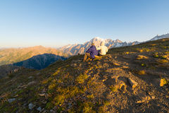 Couple watching sunrise over Mont Blanc summit Royalty Free Stock Photo