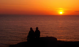 Couple watching the sunset stock images