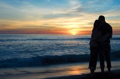 Couple Watching Sunset Stock Photos