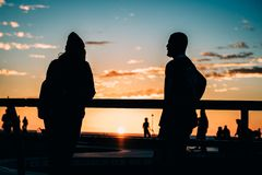 Couple watching sunset Royalty Free Stock Images