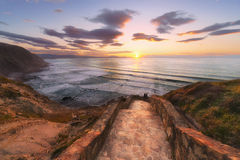 Couple watching the sunset in Barrika. Beach Royalty Free Stock Images
