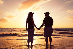 Couple Watching Sunset at the Beach. Senior Couple Enjoying Sunset at the Beach royalty free stock photos