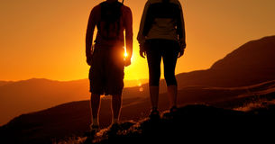 Couple Watching Sunset Mountain Outdoors Concept.  Stock Photography