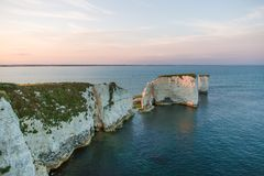 Couple Watching Sunset on Old Harry Rocks White Cliffs and Bourn royalty free stock image