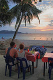 Couple are watching sunset at the Patong beach, Thailand Stock Photography