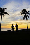 Couple watching sunset Stock Image