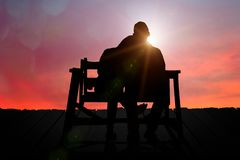 Couple watching the sunset on Valentine`s Day. Couple watching the sunset on the hill Stock Image