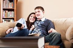 Couple watching television Stock Images