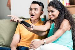 Couple watching television Stock Image