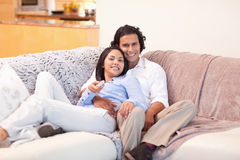 Couple watching television together Stock Image