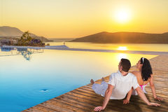 Couple watching together sunrise. In Greece Royalty Free Stock Image