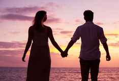 Couple watching tropical sunset Royalty Free Stock Image