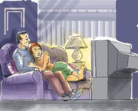 Couple are watching TV. A couple are watching Tv, woman is a bit scared and need his affection Stock Photo