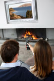 Couple watching tv Stock Images