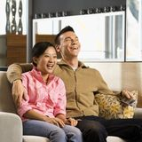 Couple watching TV. Royalty Free Stock Images