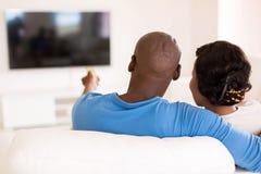 Couple watching tv Stock Photo