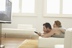 Couple Watching TV At Home Stock Image