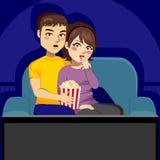Couple Watching TV At Night Stock Image