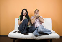 Couple watching TV  a scary movie Royalty Free Stock Photography