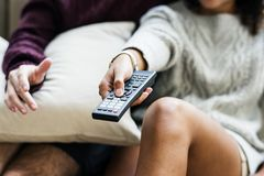 Couple watching a tv show together stock photography