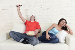 Couple watching tv sport football with man excited celebrating Stock Photography