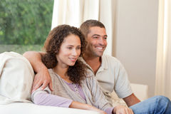 Couple watching tv in their living room Stock Photo