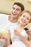 Couple watching TV together Stock Photo