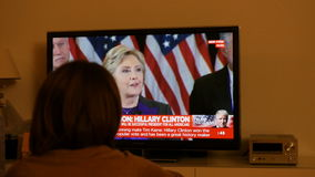 Couple watching TV after US elections listening to Hillary Clinton speech stock footage