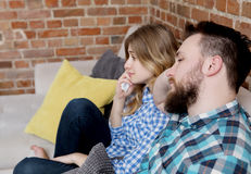 Couple watching tv. Royalty Free Stock Photos