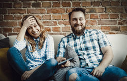 Couple watching tv. Stock Images