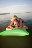 Couple in the water on a raft on holiday Royalty Free Stock Photo