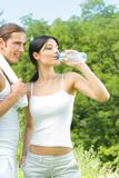 Couple with water, on workout. Couple with bottle of water, on outdoor workout Stock Photography