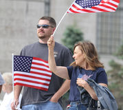 Couple waves American flags at Rally to Secure Our Borders Royalty Free Stock Image