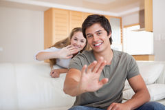 Couple waving at the camera Royalty Free Stock Photo