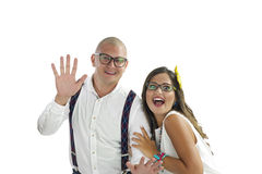 Couple waving and looking at camera Stock Photography