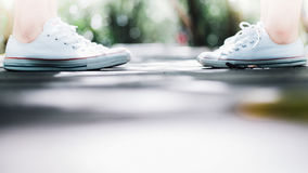 A couple wear sneaker standing confront each other along the walk way,love concept.  Royalty Free Stock Photos