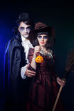 Couple wearing  as  vampire and witch. Man and women  wearing  as  vampire and witch. Halloween Royalty Free Stock Photography