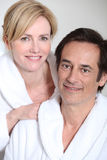 Couple wearing bath robes Royalty Free Stock Images