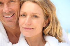 Couple wearing bath robes Royalty Free Stock Image