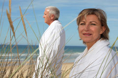 Couple wearing bathrobes Royalty Free Stock Images