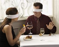 Couple wearing blindfolds Royalty Free Stock Photos